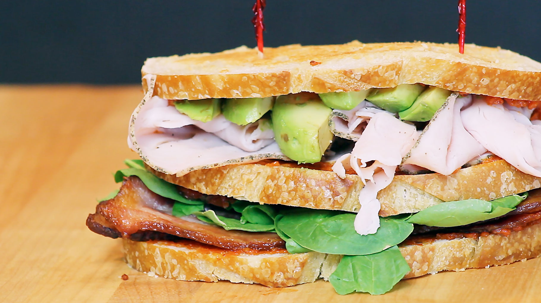 Bacon, Spinach and Sun Dried Tomato Turkey-Avocado Club Sandwich