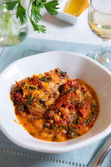 Sun Dried Tomato, Honey, Herb Chicken with Kale and White Beans