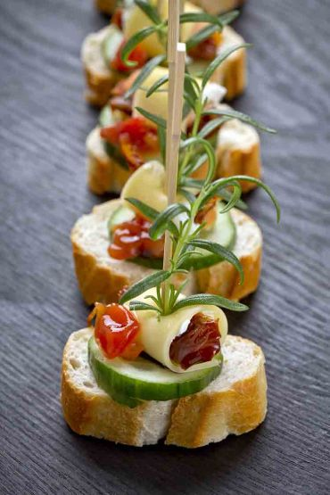 Cucumber, Prosciutto, Provalone and Roasted Tomato Canapes