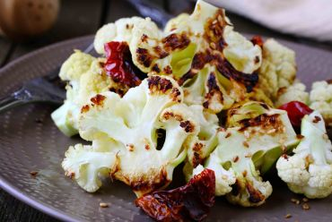 Roasted Cauliflower with Sun Dried Tomatoes and Pine Nuts