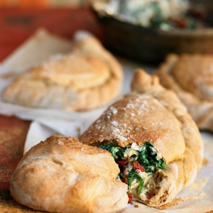 Italian Calzone with Ricotta, Spinach, Olives, & Sun Dried Tomatoes