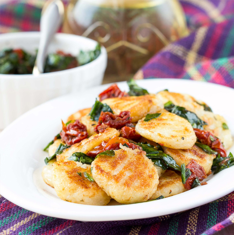 Mini Risotto Cakes with Sun Dried Tomatoes and Garlic Spinach